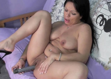 Latina Valentina is playing with her dildo